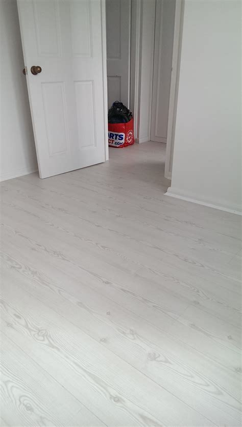 Laura Ashley Arktis pine laminate flooring installed in