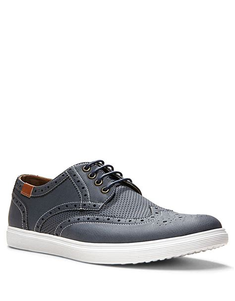 mens wingtip sneakers lyst steve madden perforated wingtip sneakers in blue