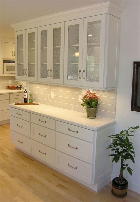standing in aisle kitchen with white brick wall