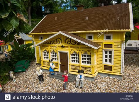 buy lego house people in front of traditional yellow lego house miniland legoland stock photo