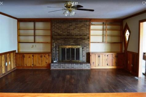 updating wood paneling painting wood paneling shelves and updating old fireplace