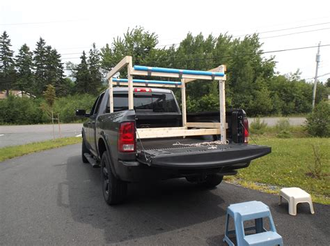 truck bed kayak rack the rack fits into the bed of the truck and is tied to the