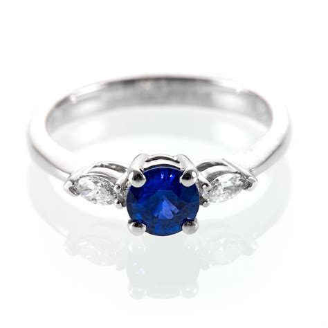marquise and sapphire engagement ring royal blue
