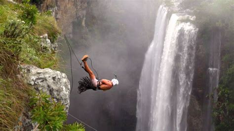 cliff rope swing daredevils take insane 600 foot rope swing bungee jumps