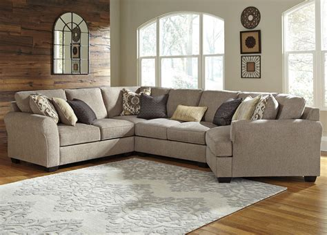 sofa with cuddler sectional benchcraft pantomine 4 piece sectional with right cuddler