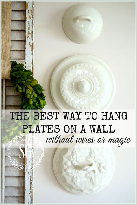 best way to hang photos on wall the best way to hang plates on a wall without wires or
