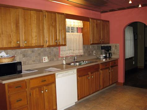 kitchen wall color ideas with oak cabinets kitchen cabinet oak honey cabinets designs photos kerala