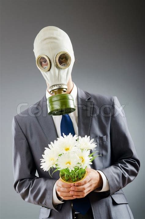 Masker Komedo Uh Mask Flower businessman with gas mask and flowers stock photo