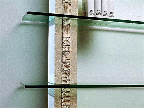 libreria etnica libreria etnica in pietra con ripiani in cristallo