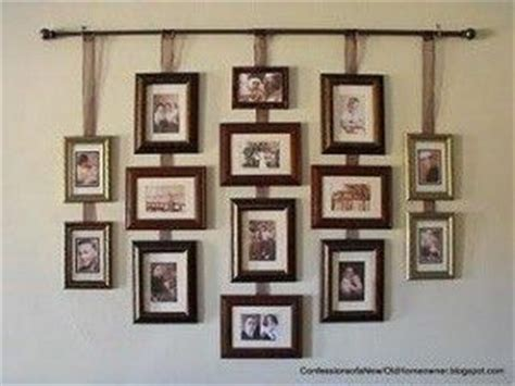how to hang framed artwork without using nails reader wonderful idea for hanging a group of pictures without