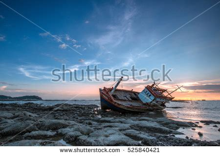 fishing boat capsized at sea free stock photo of shipwreck with rocks freerange stock