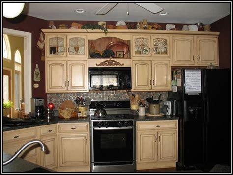 maple kitchen cabinets with black applianceshome design