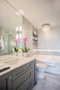 white and gray bathrooms utilizing one color in a variety of different shades creates one cohesive bathroom design http