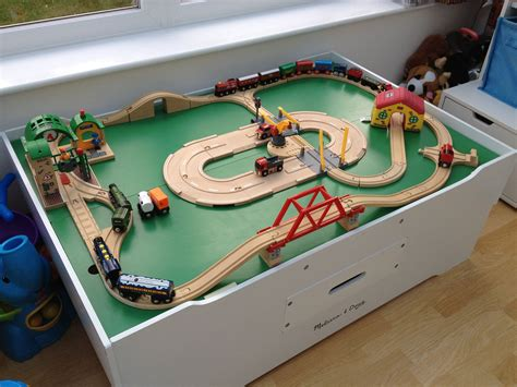 brio wooden railway system table the trains are lining up to travel around the wooden
