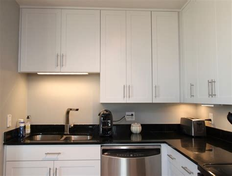 White Contemporary Kitchen with Brushed Nickel Hardware and Black Granite in DC   Contemporary