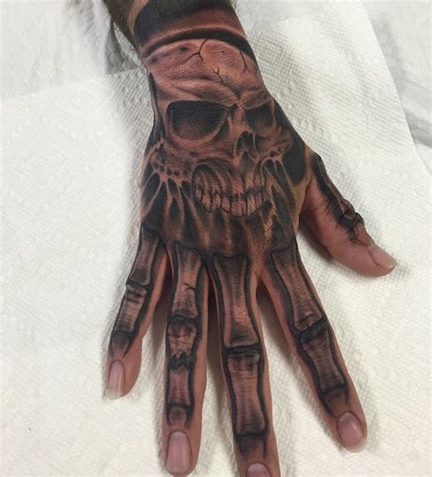 skeleton hand tattoos skull tattoos designs ideas and meaning tattoos