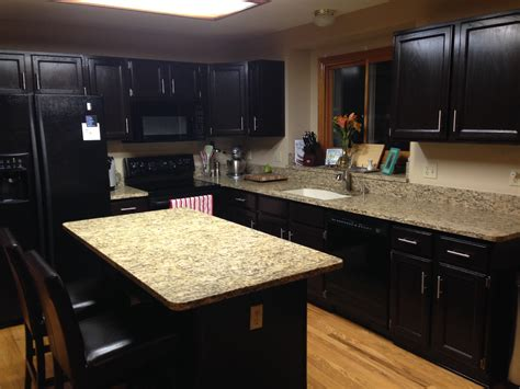 how to stain kitchen cabinets black staining oak kitchen cabinets with black color and quartz