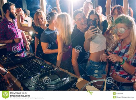 Speaker Selfie L 2 In 1 Lu Disco Multi Fungsi taking selfie in the club stock photo image of expression 40915508