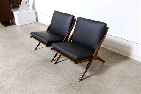 scissor couch pair of leather folke ohlsson quot scissor quot chairs at 1stdibs