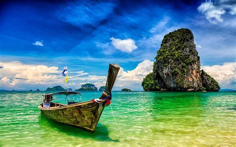 Pranang Beach And Rock Krabi Thailand Long Tail Boat On A