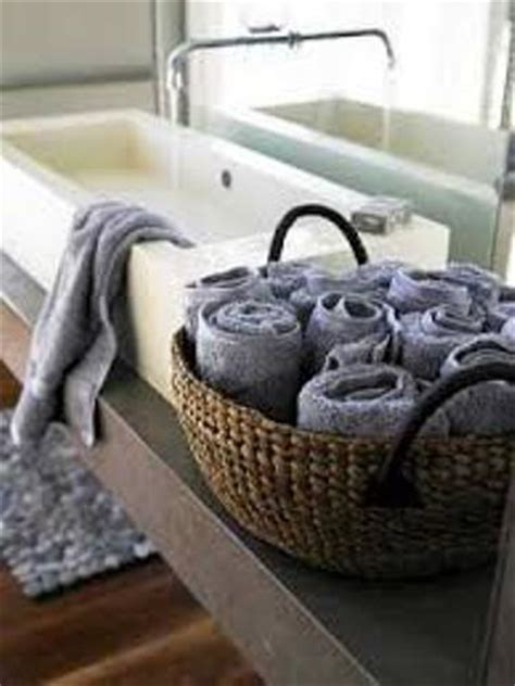 what to put in bathroom baskets how to arrange bath towels in a basket 5 guides for