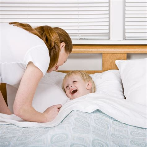 mom son bed mother putting talkative son to bed at bedtime royalty