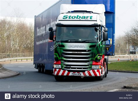 a stobart scania lorry with a tesco trailer at dirft