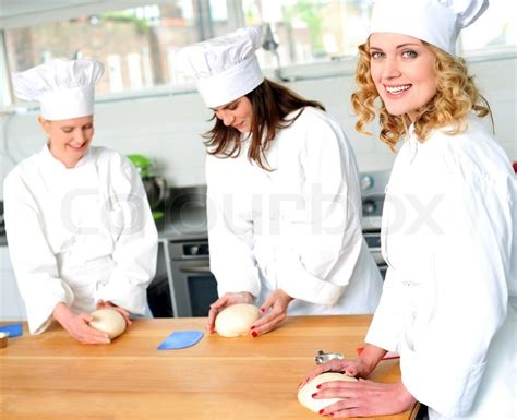 Working Conditions Of A Pastry Chef by Chefs At Work In A Restaurant Kitchen Stock Photo Colourbox