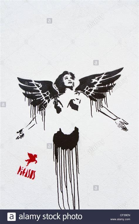 Sprei Pegasus spray paint stencil by graffiti artist pegasus near brick