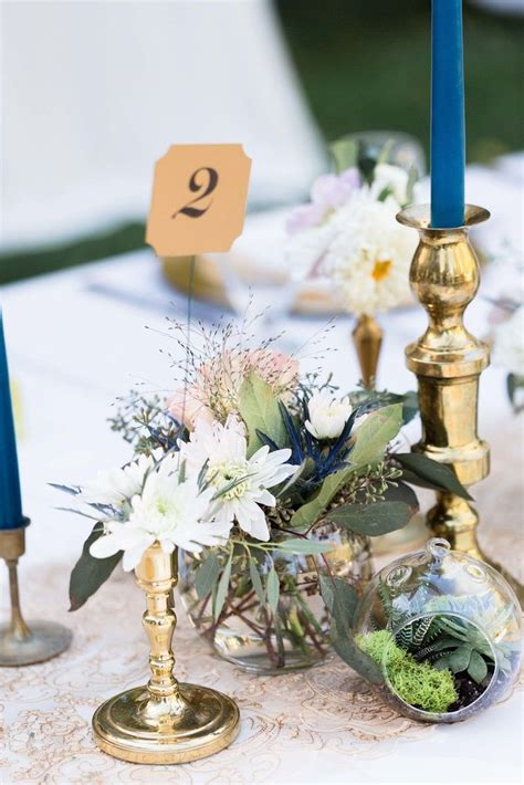 our cambray florist centerpieces on the knot vintage