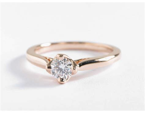 east west solitaire engagement ring in 14k gold