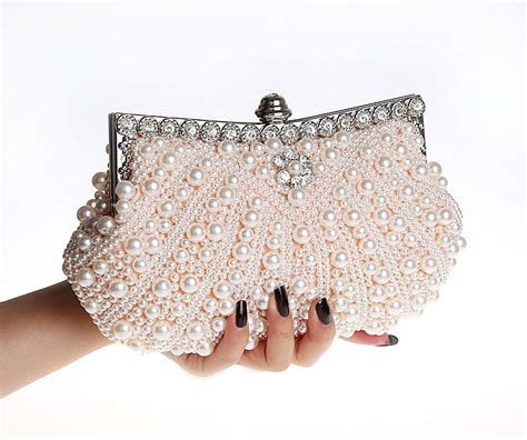 Clutch With Pearl 11 1 E1 1 2015new sided pearl evening bag shell beaded clutches type flowers bridal bag