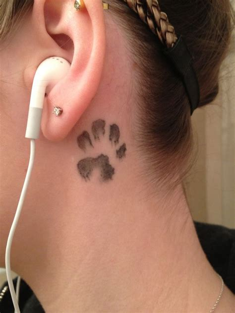 tattoo behind left ear meaning my dogs 8 week old paw print behind left ear done by