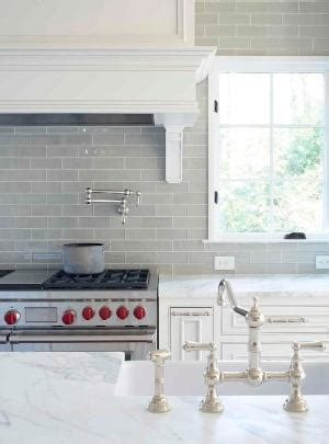 grey glass subway tile kitchen backsplash with a