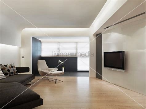 Tv Suspended From Ceiling by Minimalist Living Room With A Flat Screen Tv And Suspended