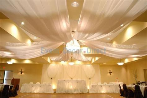 Plastic tablecloths used as drapes at a wedding reception