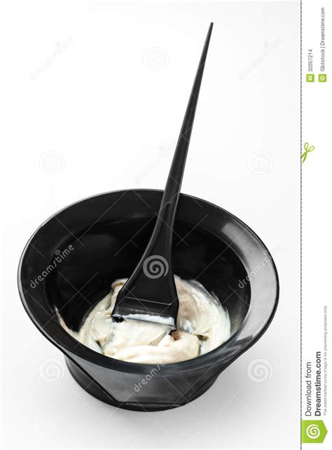 mixing hair color mixing hair color in a bowl stock photo image of