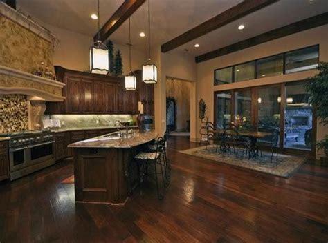 dark cabinets dark hard wood floors cedar beams