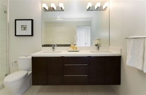 dark vanity bathroom ideas white countertop and dark cabinetry make this bathroom