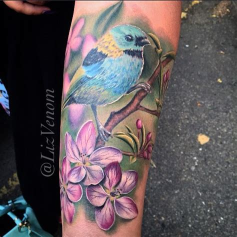 lizvenom bird and apple blossom flower tattoo by liz venom