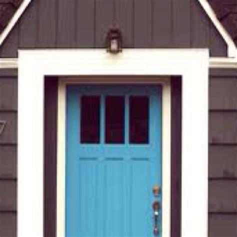 blue house with door gray house blue door front door