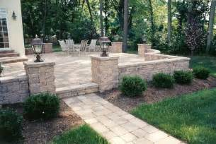 raised patio with walkway sitting walls and pillars with lights traditional patio