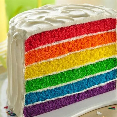 layered rainbow rainbow layer cake cake decorating