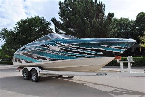 speed boat vinyl wrap tear away the teal speed boat car wrap city