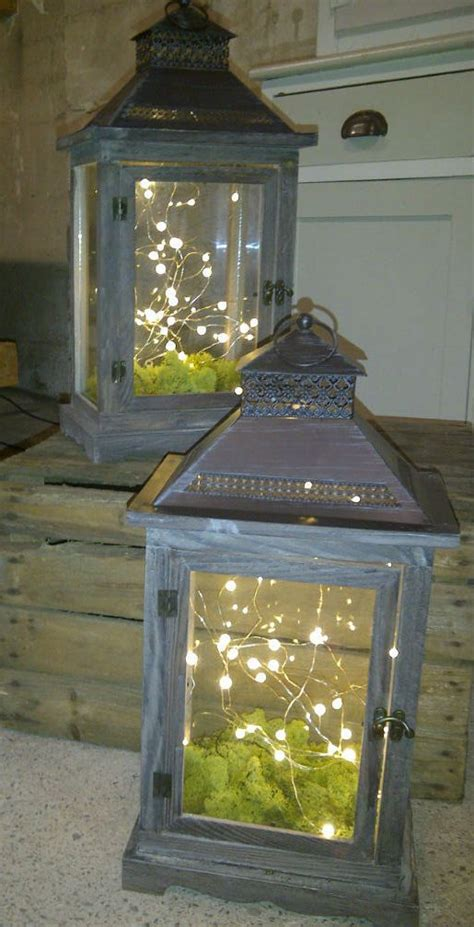 how to decorate a deck with fairy lights rustic lanterns with lights and moss pinteres