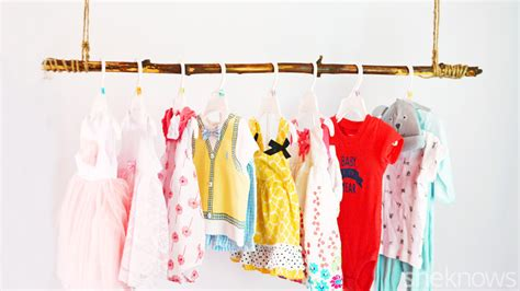 Diy this adorable tree branch clothing rod for your baby s nursery