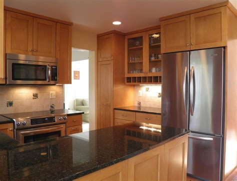 dark maple cabinets kitchen contemporary with backsplash ubatuba granite kitchen contemporary with buttercream