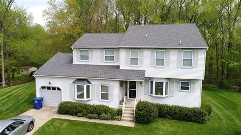 timberline pewter grey shingle with white siding lifetime roofing coated steel roofs with a