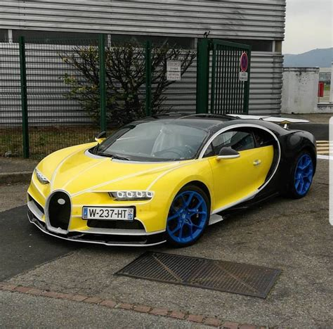 yellow bugatti chiron yellow bugatti chiron with blue wheels goes all extrovert