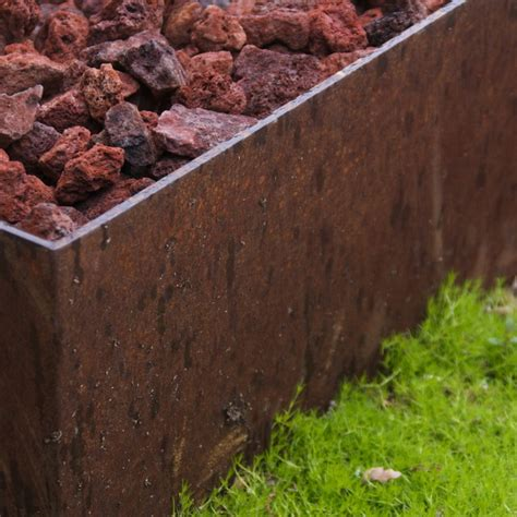 corten pit cor ten steel pit with lava rock and moss groundcover